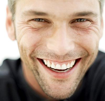 man-smiling-in-black-shirt-400
